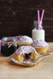 Three cupcakes with blackcurrant jam and coconut