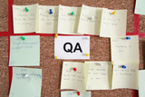 Quality assurance section with paper tickets on kanban