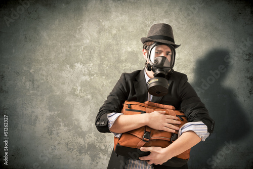 Young man with gas mask
