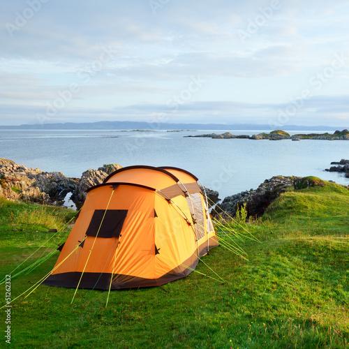 Leinwanddruck Bild Camping tent on ocean shore
