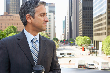 Businessman Drinking Takeaway Coffee Outside Office