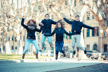 Happy Group of Friends Jumping Outdoor