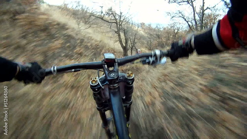 Cyclist riding down a difficult track