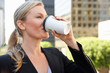 Businesswoman Drinking Takeaway Coffee Outside Office