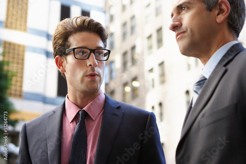 Two Businessman Chatting Outside Office