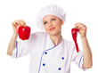 Attractive female cook in uniform holding red peppers, confused