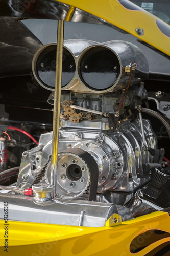 blower supercharger in a dragster engine bay