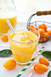 Fresh juice from oranges and kumquats