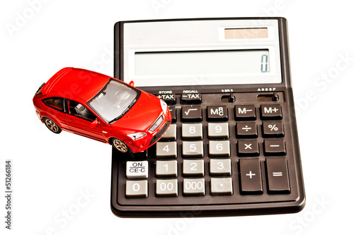 Toy car and calculator over white