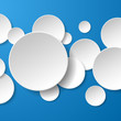 Abstract white paper circles on blue background