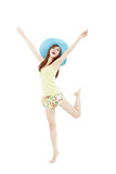 happy young woman dancing in summer during vacation isolated on