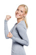 Happy woman in gray sweater with her fists up
