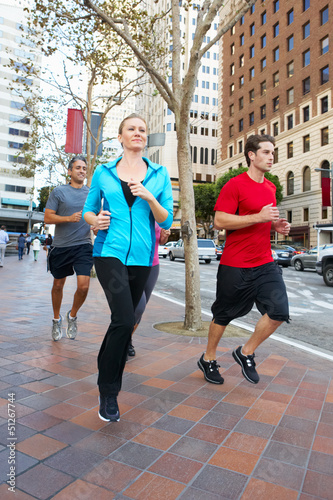 Group Of Runners On Urban Street