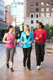 Group Of Women Power Walking On Urban Street - Fine Art prints