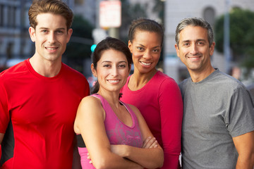 Portrait Of Running Group On Urban Street