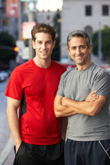 Portrait Of Two Male Runners On Urban Street