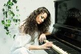 Romantic girl playing piano