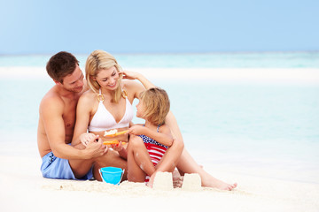 Family On Playing On Beautiful Beach