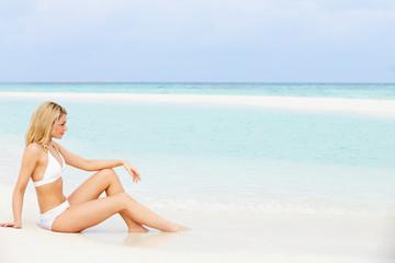 Woman Sunbathing On Beautiful Beach Holiday