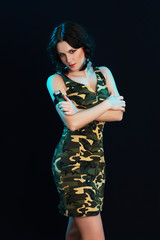 Woman in camouflage dress