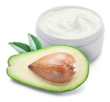 Jar of cream and slices of avocado.