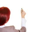 Geschäftsfrau hält Stift in die Luft