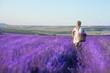 Beautiful woman in blossom lavendre fiel flowers