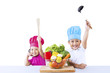 Happy chef kids with vegetable