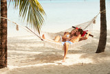 Romantic Couple Relaxing In Beach Hammock
