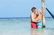 Senior Romantic Couple Standing In Beautiful Tropical Sea