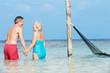 Romantic Senior Couple Standing In Beautiful Tropical Sea