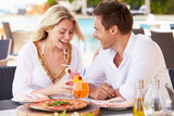 Couple Enjoying Meal In Outdoor Restaurant