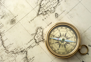 old compass on vintage map 1732