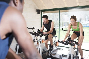 Fitness coach and two friends at a exercise bike class