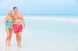 Senior Romantic Couple Walking In Beautiful Tropical Sea
