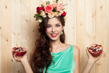 smiling girl with flower crown and pomegranate