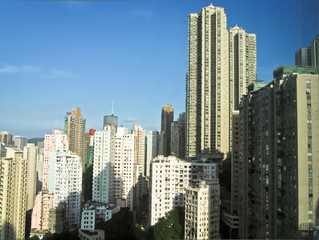 Skyscrapers in Hong Kong with sun