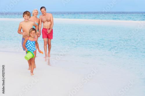 Grandparents And Grandchildren Having Fun On Beach Holiday