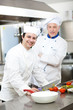Portrait of two chefs in a restaurant kitchen