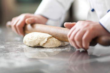 Chef preparing dough in a kitchen