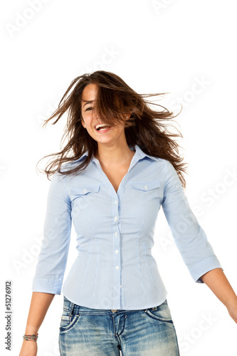 young woman dancing in studio, isolated on white background