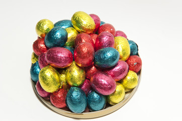 Colored Easter eggs on a dish