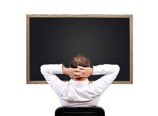 man looking on blackboard