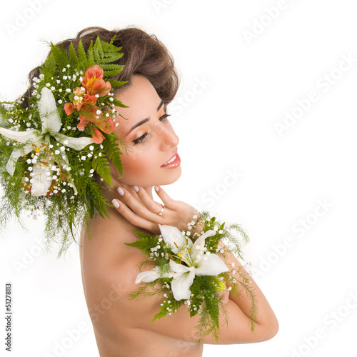 A beautiful girl with the lilies on a white background