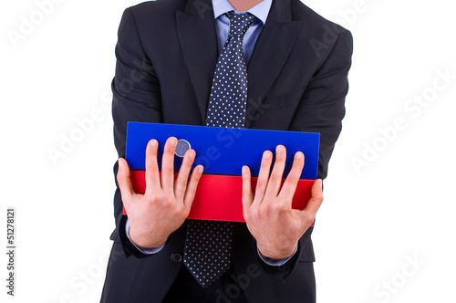 Businessman holding folders.