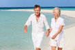 Senior Romantic Couple Walking On Beautiful Tropical Beach