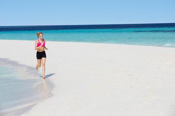 Woman Running On Beautiful Beach