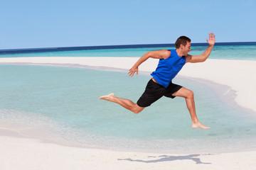 Man Exercising On Beautiful Beach