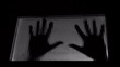 trapped man hands knocking on door