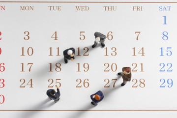 カレンダーとビジネスマン